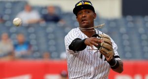 The New York Yankees have sent third base prospect Miguel Andujar to Triple-A, while outfielder Estevan Florialheads to their minor league camp.