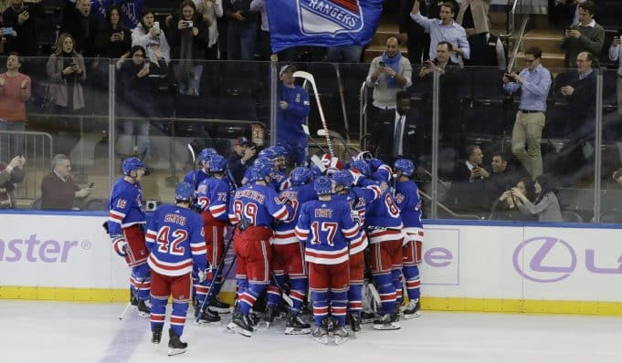 New York Rangers celebrate a 3-2 overtime win over the Minnesota Wild.
