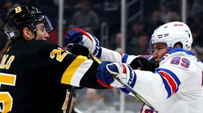 Pavel Buchnevich and Brandon Carlo get in a tussle in the Boston Bruins 3-2 overtime victory over the New York Rangers.