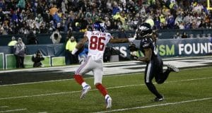 New York Giants' Darius Slayton (86) stiff-arms Philadelphia Eagles' Ronald Darby (21) to score a touchdown during the first half of an NFL football game, Monday, Dec. 9, 2019, in Philadelphia.