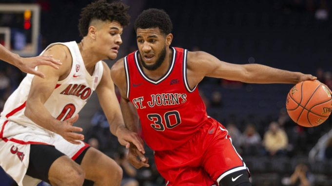 St. John's guard LJ Figueroa (30) tries to drive past Arizona guard Josh Green (0) during the first half of an NCAA college basketball game Saturday, Dec. 21, 2019, in San Francisco.