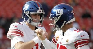 New York Giants quarterback Daniel Jones (8) and quarterback Eli Manning (10) talk while working out prior to an NFL football game against the Washington Redskins, Sunday, Dec. 22, 2019, in Landover, Md.