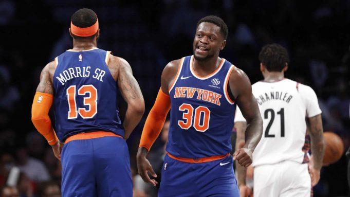 New York Knicks forward Julius Randle (30) looks around Knicks forward Marcus Morris Sr. (13) as Brooklyn Nets forward Wilson Chandler (21) walks away during the second half of an NBA basketball game, Thursday, Dec. 26, 2019, in New York.