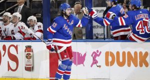 New York Rangers center Mika Zibanejad (93) is congratulated after he scored during the first period of the team's NHL hockey game against the Carolina Hurricanes, Friday, Dec. 27, 2019, in New York.