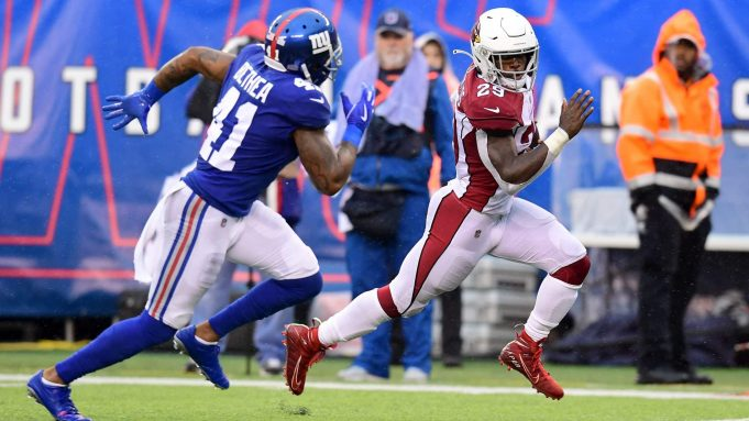 EAST RUTHERFORD, NEW JERSEY - OCTOBER 20: Antoine Bethea #41 of the New York Giants chases Chase Edmonds #29 of the Arizona Cardinals as he runs the ball for touchdown in the third quarter of their game at MetLife Stadium on October 20, 2019 in East Rutherford, New Jersey.