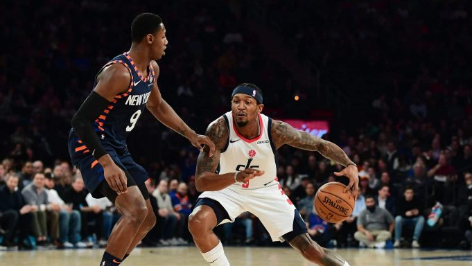 NEW YORK, NEW YORK - DECEMBER 23: Bradley Beal #3 of the Washington Wizards looks to drive past RJ Barrett #9 of the New York Knicks during the first half of their game at Madison Square Garden on December 23, 2019 in New York City. NOTE TO USER: User expressly acknowledges and agrees that, by downloading and or using this photograph, User is consenting to the terms and conditions of the Getty Images License Agreement.
