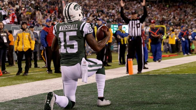 EAST RUTHERFORD, NJ - NOVEMBER 27: Brandon Marshall #15 of the New York Jets celebrates after scoring a one yard touchdown pass against Malcolm Butler #21 of the New England Patriots during the second quarter in the game at MetLife Stadium on November 27, 2016 in East Rutherford, New Jersey.