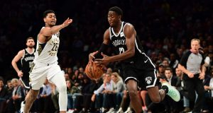 NEW YORK, NEW YORK - OCTOBER 30: Caris LeVert #22 of the Brooklyn Nets takes control of the ball as Jeremy Lamb #26 of the Indiana Pacers guards him during the first half of their game at Barclays Center on October 30, 2019 in the Brooklyn borough of New York City. NOTE TO USER: User expressly acknowledges and agrees that, by downloading and or using this Photograph, user is consenting to the terms and conditions of the Getty Images License Agreement.