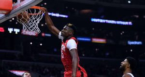 LOS ANGELES, CALIFORNIA - DECEMBER 19: Clint Capela #15 of the Houston Rockets scores on a dunk in front of Ivica Zubac #40 and Paul George #13 of the LA Clippers during a 122-117 Houston Rockets win at Staples Center on December 19, 2019 in Los Angeles, California. NOTE TO USER: User expressly acknowledges and agrees that, by downloading and or using this photograph, User is consenting to the terms and conditions of the Getty Images License Agreement.