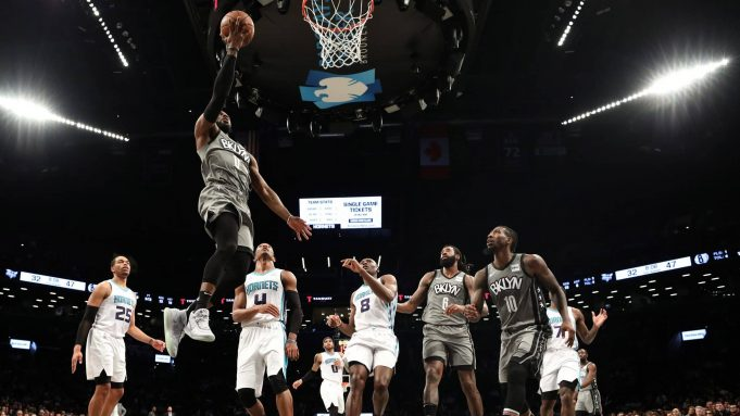 NEW YORK, NEW YORK - DECEMBER 11: David Nwaba #0 of the Brooklyn Nets goes in for a layup during the first half of their game against the Charlotte Hornets at Barclays Center on December 11, 2019 in New York City. NOTE TO USER: User expressly acknowledges and agrees that, by downloading and or using this photograph, User is consenting to the terms and conditions of the Getty Images License Agreement.