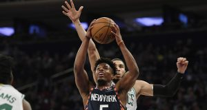 New York Knicks guard Dennis Smith Jr. (5) attempts a basket during the first half of an NBA basketball game against the Boston Celtics, Sunday, Dec. 1, 2019, in New York.