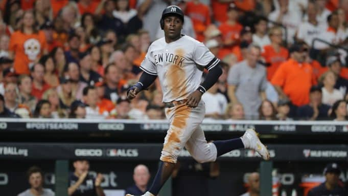 HOUSTON, TEXAS - OCTOBER 19: Didi Gregorius #18 of the New York Yankees scores a run against the Houston Astros during the second inning in game six of the American League Championship Series at Minute Maid Park on October 19, 2019 in Houston, Texas.