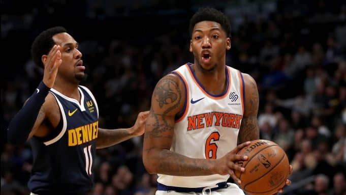 DENVER, COLORADO - DECEMBER 15: Elfrid Payton #6 of the New York Knicks drives against Monte Morris #11 of the Denver Nuggets in the first quarter at the Pepsi Center on December 15, 2019 in Denver, Colorado. NOTE TO USER: User expressly acknowledges and agrees that, by downloading and or using this photograph, User is consenting to the terms and conditions of the Getty Images License Agreement.