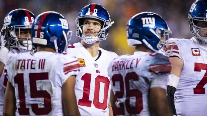 PHILADELPHIA, PA - DECEMBER 09: Eli Manning #10 of the New York Giants looks to the scoreboard from a huddle during the third quarter against the Philadelphia Eagles at Lincoln Financial Field on December 9, 2019 in Philadelphia, Pennsylvania. Philadelphia defeats New York in overtime 23-17.
