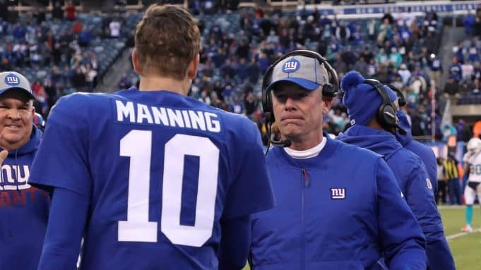 EAST RUTHERFORD, NEW JERSEY - DECEMBER 15: Eli Manning #10 of the New York Giants hugs head coach Pat Shurmur of the New York Giants in the final seconds of their 31-13 win against the Miami dolphins at MetLife Stadium on December 15, 2019 in East Rutherford, New Jersey.