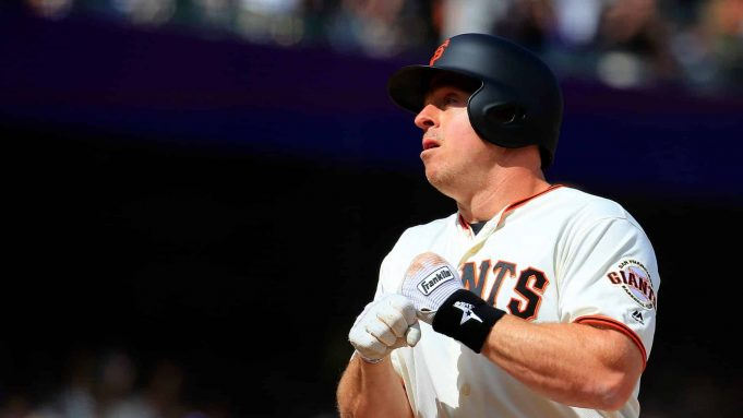 SAN FRANCISCO, CALIFORNIA - APRIL 27: Erik Kratz #5 of the San Francisco Giants celebrates a solo home run during the ninth inning against the New York Yankees at Oracle Park on April 27, 2019 in San Francisco, California.
