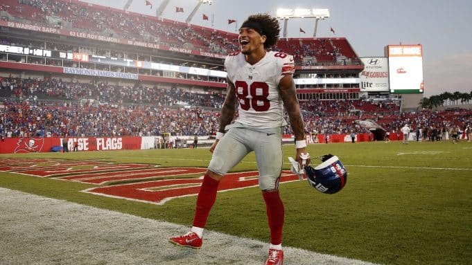 TAMPA, FLORIDA - SEPTEMBER 22: Evan Engram #88 of the New York Giants celebrates after defeating the Tampa Bay Buccaneers 32-31 at Raymond James Stadium on September 22, 2019 in Tampa, Florida.