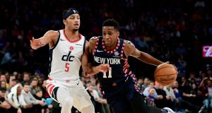 NEW YORK, NEW YORK - DECEMBER 23: Frank Ntilikina #11 of the New York Knicks drives past Justin Robinson #5 of the Washington Wizards during the second half of their game at Madison Square Garden on December 23, 2019 in New York City. NOTE TO USER: User expressly acknowledges and agrees that, by downloading and or using this photograph, User is consenting to the terms and conditions of the Getty Images License Agreement.