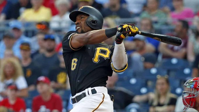 PITTSBURGH, PA - JULY 23: Starling Marte #6 of the Pittsburgh Pirates hits a three-run home run in the first inning against the St. Louis Cardinals at PNC Park on July 23, 2019 in Pittsburgh, Pennsylvania.