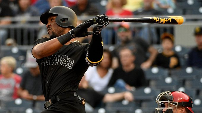 PITTSBURGH, PA - AUGUST 23: Starling Marte #6 of the Pittsburgh Pirates hits a single to center field in the first inning during the game against the Cincinnati Reds at PNC Park on August 23, 2019 in Pittsburgh, Pennsylvania. Teams are wearing special color schemed uniforms with players choosing nicknames to display for Players' Weekend.