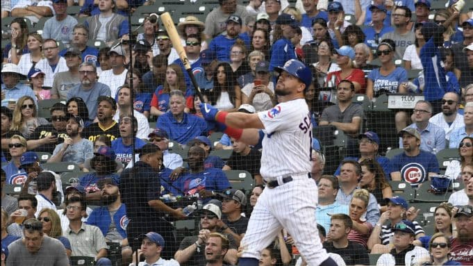 CHICAGO, ILLINOIS - SEPTEMBER 15: Kyle Schwarber #12 of the Chicago Cubs watches his two-run home run against the Pittsburgh Pirates during the seventh inning at Wrigley Field on September 15, 2019 in Chicago, Illinois.