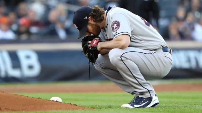 NEW YORK, NEW YORK - OCTOBER 15: Gerrit Cole #45 of the Houston Astros reacts during the first inning against the New York Yankees in game three of the American League Championship Series at Yankee Stadium on October 15, 2019 in New York City.