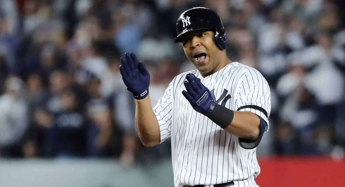 NEW YORK, NEW YORK - OCTOBER 15: Edwin Encarnacion #30 of the New York Yankees celebrates hitting a double during the fifth inning against the Houston Astros in game three of the American League Championship Series at Yankee Stadium on October 15, 2019 in New York City.