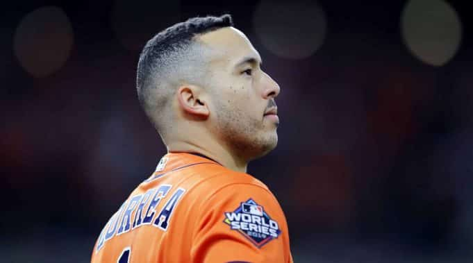 HOUSTON, TEXAS - OCTOBER 30: Carlos Correa #1 of the Houston Astros reacts after hitting an RBI single against the Washington Nationals during the fifth inning in Game Seven of the 2019 World Series at Minute Maid Park on October 30, 2019 in Houston, Texas.