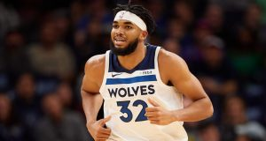 MINNEAPOLIS, MINNESOTA - OCTOBER 27: Karl-Anthony Towns #32 of the Minnesota Timberwolves runs down the court against the Miami Heat during the home opener at Target Center on October 27, 2019 in Minneapolis, Minnesota. The Timberwolves defeated the Heat 116-109. NOTE TO USER: User expressly acknowledges and agrees that, by downloading and or using this Photograph, user is consenting to the terms and conditions of the Getty Images License Agreement.