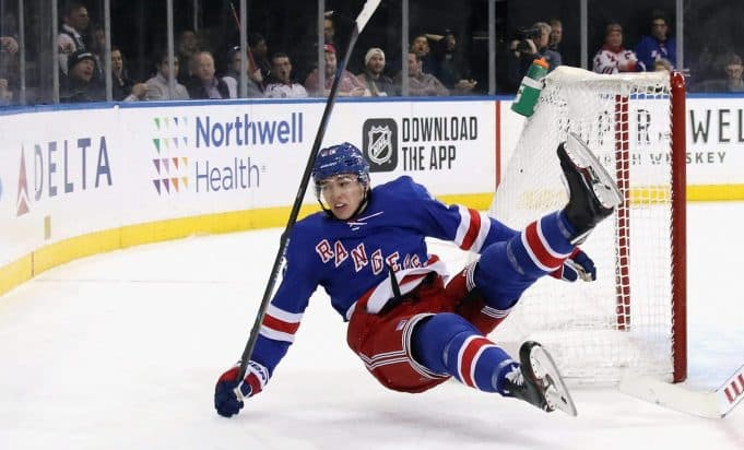 NEW YORK, NEW YORK - NOVEMBER 06: Libor Hajek #25 of the New York Rangers is tripped up by Jimmy Howard #35 of the Detroit Red Wings during the second period at Madison Square Garden on November 06, 2019 in New York City. The Rangers defeated the Red Wings 5-1.