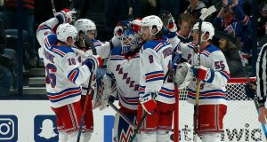 COLUMBUS, OH - DECEMBER 5: Alexandar Georgiev #40 of the New York Rangers is congratulated by his teammates after defeating the Columbus Blue Jackets 3-2 on December 5, 2019 at Nationwide Arena in Columbus, Ohio.