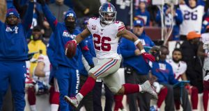 LANDOVER, MD - DECEMBER 22: Saquon Barkley #26 of the New York Giants carries the ball during the second half against the Washington Redskins at FedExField on December 22, 2019 in Landover, Maryland.