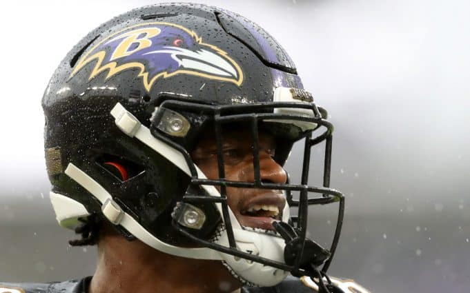 BALTIMORE, MARYLAND - DECEMBER 01: Lamar Jackson #8 of the Baltimore Ravens celebrates against the San Francisco 49ers after throwing a first quarter touchdown pass at M&T Bank Stadium on December 01, 2019 in Baltimore, Maryland.