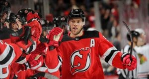 NEWARK, NEW JERSEY - DECEMBER 06: Taylor Hall #9 of the New Jersey Devils celebrates his goal with teammates on the bench in the first period against the Chicago Blackhawks at Prudential Center on December 06, 2019 in Newark, New Jersey.