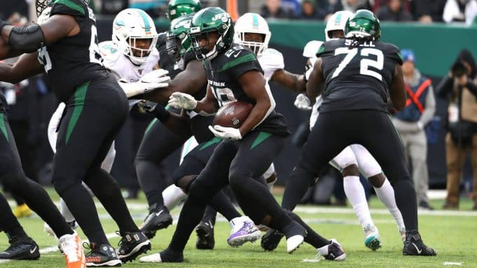 EAST RUTHERFORD, NEW JERSEY - DECEMBER 08: Bilal Powell #29 of the New York Jets runs against the Miami dolphins during their game at MetLife Stadium on December 08, 2019 in East Rutherford, New Jersey.