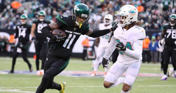 EAST RUTHERFORD, NEW JERSEY - DECEMBER 08: Robby Anderson #11 of the New York Jets runs against Ryan Lewis #24 of the Miami Dolphins during their game at MetLife Stadium on December 08, 2019 in East Rutherford, New Jersey.