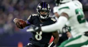 BALTIMORE, MARYLAND - DECEMBER 12: Quarterback Lamar Jackson #8 of the Baltimore Ravens breaks NFL single season record for rushing yards by a quarterback, formerly held by Michael Vick in the first quarter of the game against the New York Jets at M&T Bank Stadium on December 12, 2019 in Baltimore, Maryland.