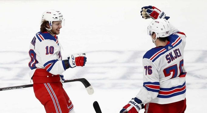 SAN JOSE, CALIFORNIA - DECEMBER 12: Artemi Panarin #10 of the New York Rangers is congratulated by Brady Skjei #76 after he scored an empty net goal against the San Jose Sharks for his third goal of the game at SAP Center on December 12, 2019 in San Jose, California.