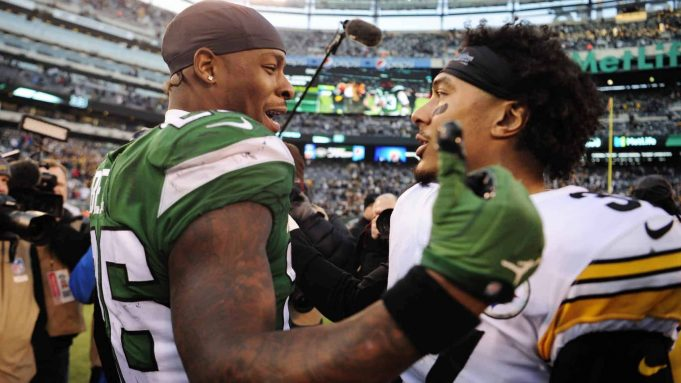 EAST RUTHERFORD, NEW JERSEY - DECEMBER 22: Le'Veon Bell #26 of the New York Jets greets Jordan Dangerfield #37 of the Pittsburgh Steelers after the game at MetLife Stadium on December 22, 2019 in East Rutherford, New Jersey.