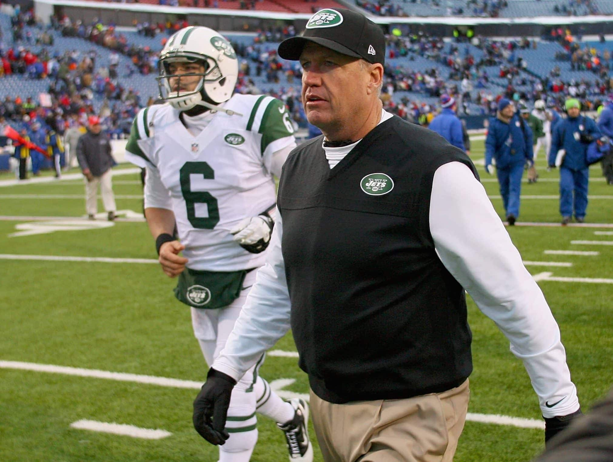 ORCHARD PARK, NY - DECEMBER 30: Head coach Rex Ryan and Mark Sanchez #6 of the New York Jets walk off the field after losing to the Buffalo Bills 28-9 at Ralph Wilson Stadium on December 30, 2012 in Orchard Park, New York.