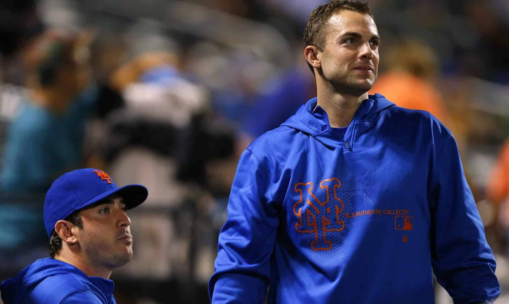 NEW YORK, NY - AUGUST 26: Injured pitcher Matt Harvey #33 and third baseman David Wright #5 of the New York Mets looks on from the dugout during a game against the Philadelphia Phillies on August 26, 2013 at Citi Field in the Flushing neighborhood of the Queens borough of New York City. It was announced before the game that Harvey was diagnosed with a partially torn ulnar collateral ligament (UCL) and Wright is recovering from a a hamstring injury.