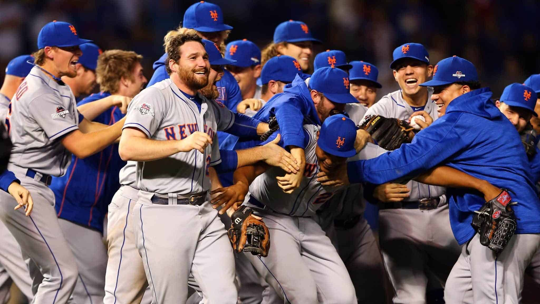 CHICAGO, IL - OCTOBER 21: Daniel Murphy #28 of the New York Mets celebrates with his teammates after defeating the Chicago Cubs in game four of the 2015 MLB National League Championship Series at Wrigley Field on October 21, 2015 in Chicago, Illinois. The Mets defeated the Cubs with a score of 8 to 3 to sweep Championship Series.