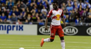 MONTREAL, QC - MARCH 12: Kemar Lawrence #92 of the New York Red Bulls runs with the ball during the MLS game against the Montreal Impact at the Olympic Stadium on March 12, 2016 in Montreal, Quebec, Canada. The Montreal Impact defeated the New York Red Bulls 3-0.