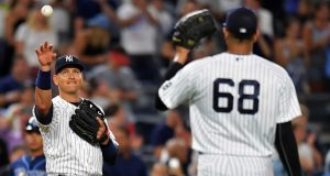 NEW YORK, NY - AUGUST 12: Alex Rodriguez #13 of the New York Yankees throws the ball to Dellin Betances #68 in the ninth inning against the Tampa Bay Rays at Yankee Stadium on August 12, 2016 in New York City.