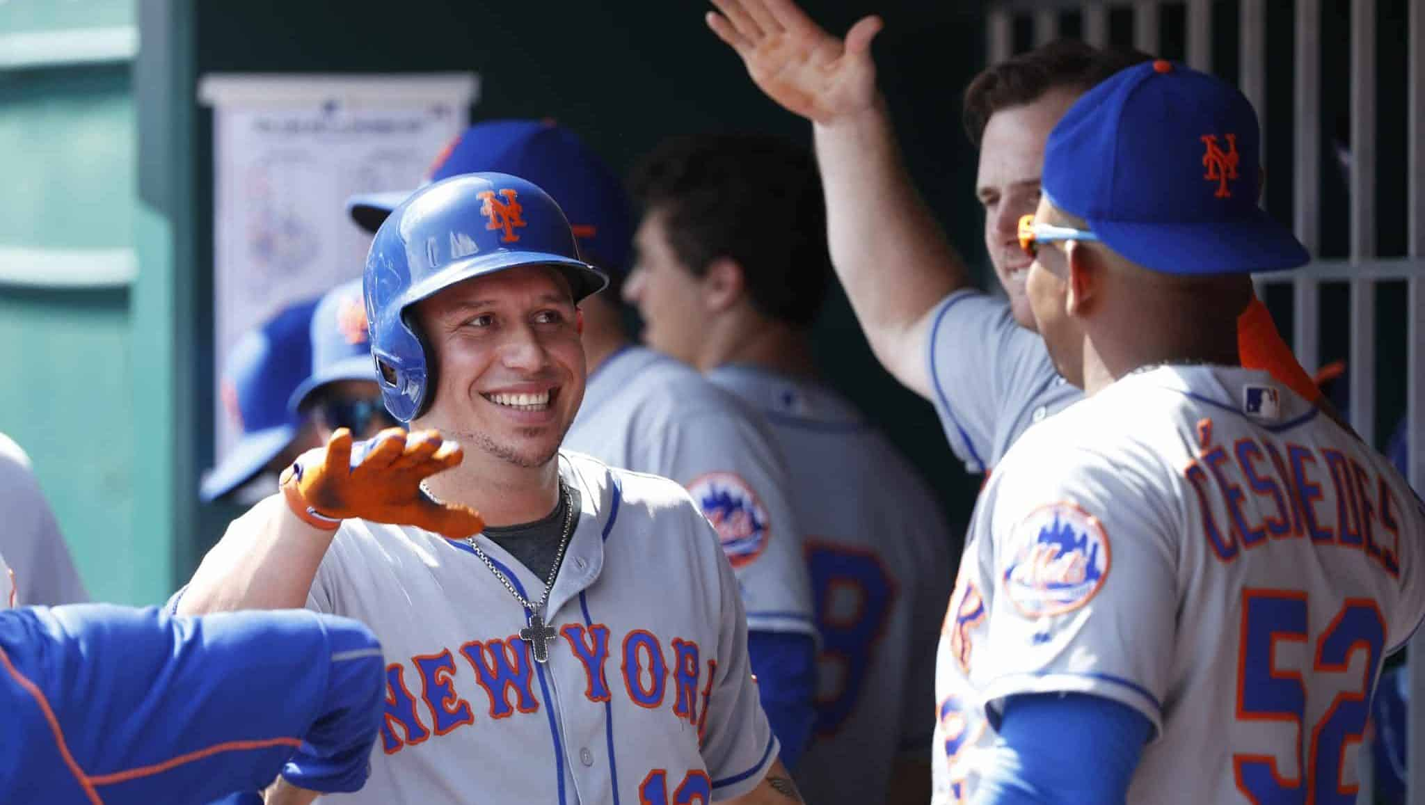 CINCINNATI, OH - SEPTEMBER 05: Asdrubal Cabrera #13 of the New York Mets celebrates after a pinch hit single to drive in a run in the seventh inning against the Cincinnati Reds at Great American Ball Park on September 5, 2016 in Cincinnati, Ohio. The Mets defeated the Reds 5-0.