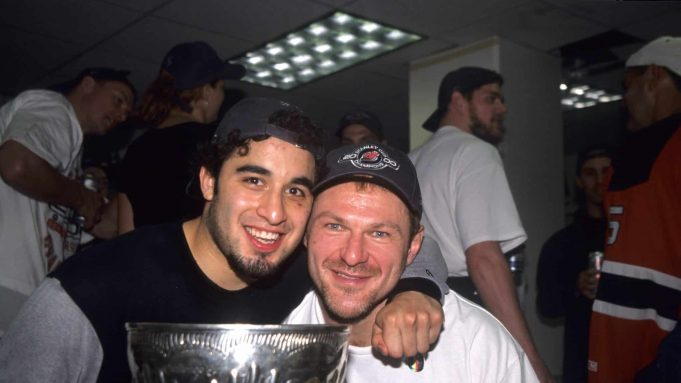 DALLAS - JUNE 10: Claude Lemieux #22 of the New Jersey Devils and Scott Gomez celebrate with the Stanley Cup Trophy after winning the 2000 Stanley Cup Finals game against the Dallas Stars at Reunion Arena on June 10, 2000 in Dallas, Texas.