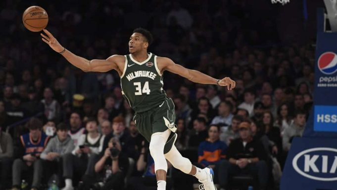Milwaukee Bucks forward Giannis Antetokounmpo (34) passes the ball during the second half of the team's NBA basketball game against the New York Knicks in New York, Saturday, Dec. 21, 2019.