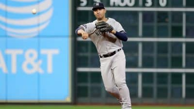 HOUSTON, TEXAS - OCTOBER 19: Gleyber Torres #25 of the New York Yankees throws out the runner against the New York Yankees during the third inning in game six of the American League Championship Series at Minute Maid Park on October 19, 2019 in Houston, Texas.
