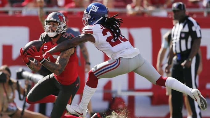 TAMPA, FLORIDA - SEPTEMBER 22: Mike Evans #13 of the Tampa Bay Buccaneers makes a catch in the end zone for a touchdown against Janoris Jenkins #20 of the New York Giants during the first quarter at Raymond James Stadium on September 22, 2019 in Tampa, Florida/