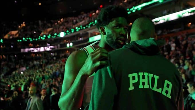 BOSTON, MASSACHUSETTS - DECEMBER 12: Joel Embiid #21 of the Philadelphia 76ers talks with Al Horford #42 before the game against the Boston Celtics at TD Garden on December 12, 2019 in Boston, Massachusetts. NOTE TO USER: User expressly acknowledges and agrees that, by downloading and or using this photograph, User is consenting to the terms and conditions of the Getty Images License Agreement.